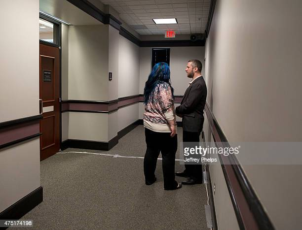 Dustin Diamond and fiancee Amanda Schutz stand in a hallway outside a courtroom during a break of his trial in the Ozaukee County Courthouse May 29...
