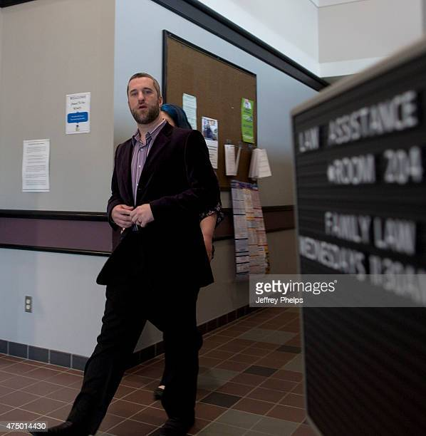 Dustin Diamond and fiancee Amanda Schutz walk in the Ozaukee County Courthouse for their trial on May 28 2015 in Port Washington Wisconsin Diamond...