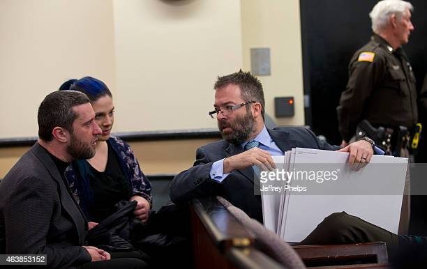 Dustin Diamond left and Amanda Schutz middle speak with their attorney as they attend further proceedings at Ozaukee County Courthouse on February 19...