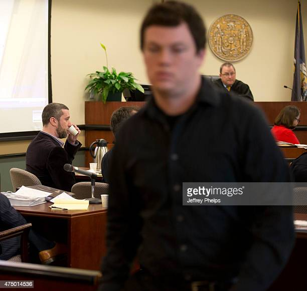 Dustin Diamond left sips water as Casey Smet leaves the courtroom during his trial in the Ozaukee County Courthouse May 28 2015 in Port Washington...