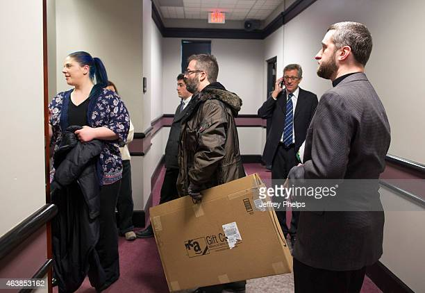 Dustin Diamond right and Amanda Schutz left enter the courtroom with their attorney as they attend further proceedings at Ozaukee County Courthouse...