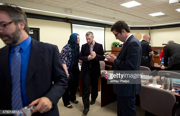 Dustin Diamond third from left and fiancee Amanda Schutz left the courtroom during his trial in the Ozaukee County Courthouse May 28 2015 in Port...