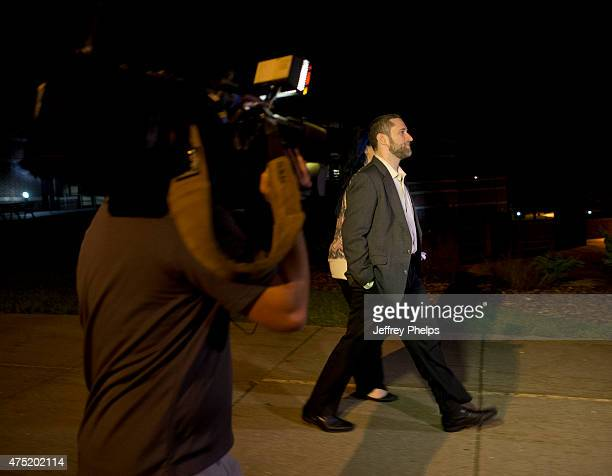 Dustin Diamond walks outside of the courthouse with fiancee Amanda Schutz after a split verdict in an Ozaukee County Courthouse May 29 2015 in Port...