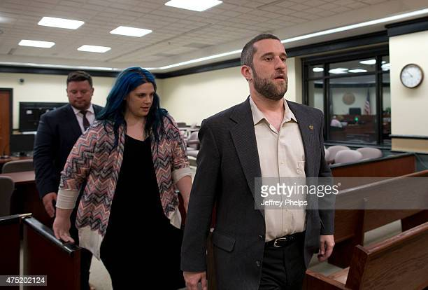 Dustin Diamond with his fiancee Amanda Schutz and her attorney walk out of the coutroom after a split verdict in an Ozaukee County Courthouse May 29...
