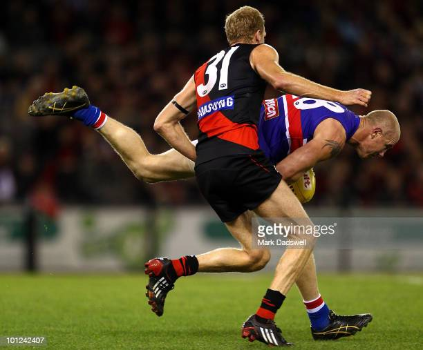 Dustin Fletcher of the Bombers attempts to spoil Barry Hall of the Bulldogs during the round 10 AFL match between the Essendon Bombers and the...