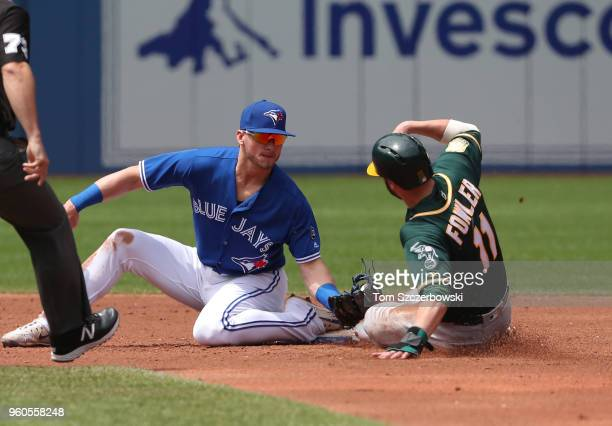 Dustin Fowler of the Oakland Athletics is caught stealing second base in the third inning during MLB game action as Josh Donaldson of the Toronto...