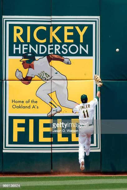 Dustin Fowler of the Oakland Athletics is unable to field a fly ball hit for an RBI double by Jose Ramirez of the Cleveland Indians during the fifth...