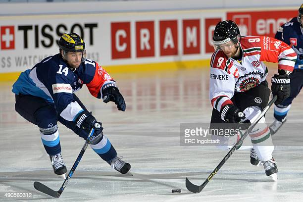 Dustin Friesen battles with Spencer Abbott during the Champions Hockey League round of thirtytwo game between ERC Ingolstadt and Frolunda Gothenburg...