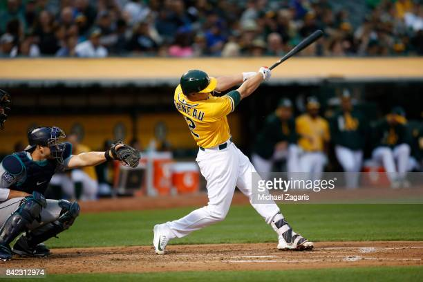 Dustin Garneau of the Oakland Athletics bats during the game against the Seattle Mariners at the Oakland Alameda Coliseum on August 8 2017 in Oakland...