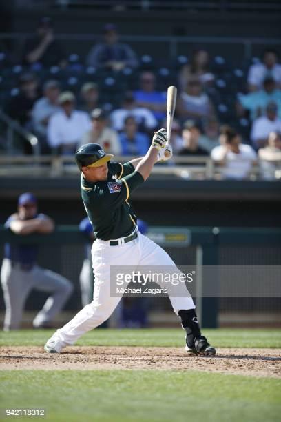 Dustin Garneau of the Oakland Athletics bats during the game against the Texas Rangers at Hohokam Stadium on March 1 2018 in Mesa Arizona Dustin...