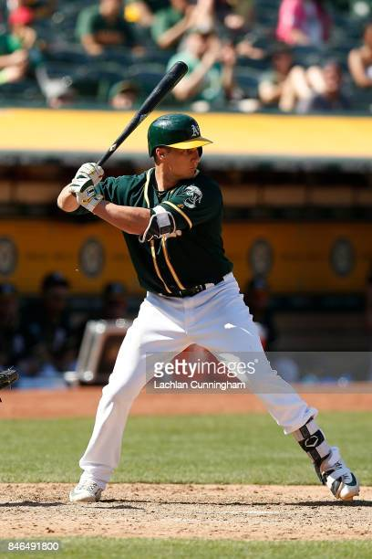 Dustin Garneau of the Oakland Athletics bats in the sixth inning against the Houston Astros at Oakland Alameda Coliseum on September 10 2017 in...