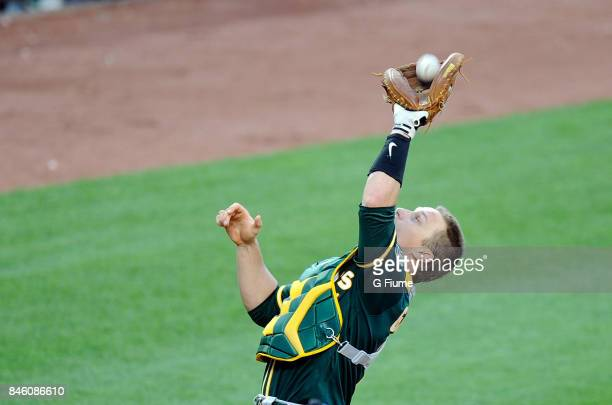 Dustin Garneau of the Oakland Athletics catches a pop up during the game against the Baltimore Orioles at Oriole Park at Camden Yards on August 23...