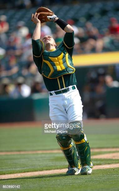 Dustin Garneau of the Oakland Athletics catches a popup during the game against the Los Angeles Angels of Anaheim at the Oakland Alameda Coliseum on...