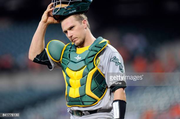Dustin Garneau of the Oakland Athletics catches against the Baltimore Orioles at Oriole Park at Camden Yards on August 21 2017 in Baltimore Maryland