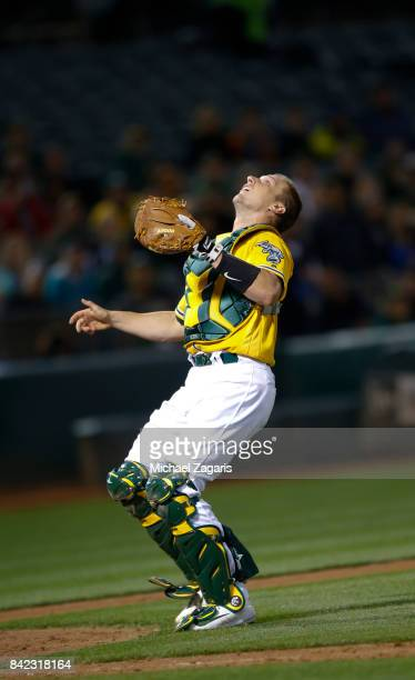 Dustin Garneau of the Oakland Athletics chases a popup during the game against the Seattle Mariners at the Oakland Alameda Coliseum on August 8 2017...