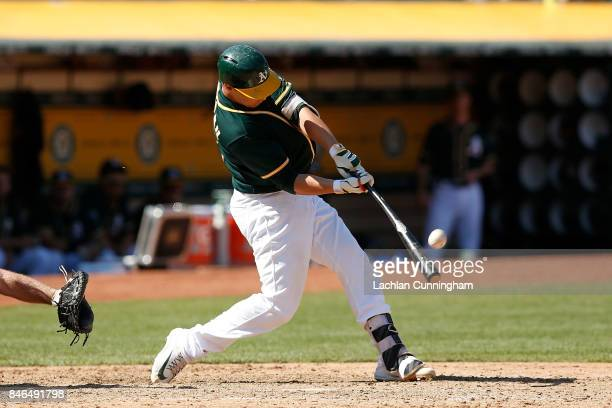 Dustin Garneau of the Oakland Athletics pops out in the sixth inning against the Houston Astros at Oakland Alameda Coliseum on September 10 2017 in...