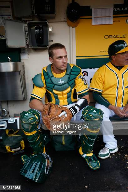 Dustin Garneau of the Oakland Athletics sits in the dugout prior to the game against the Seattle Mariners at the Oakland Alameda Coliseum on August 8...