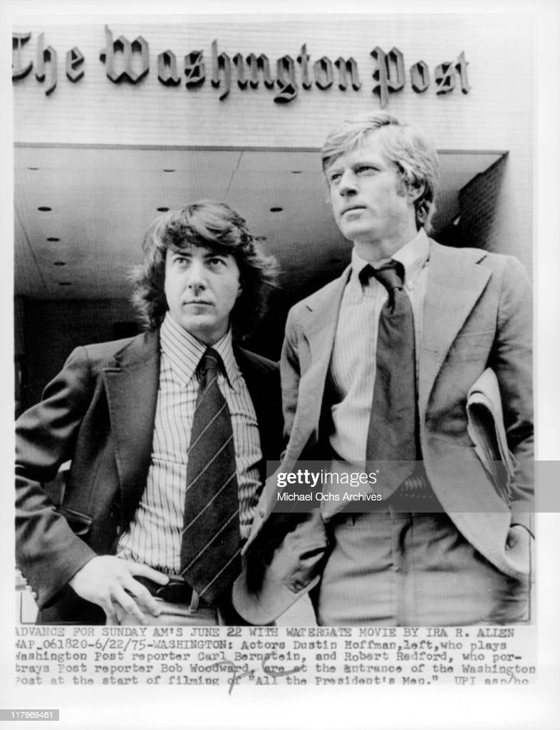 Dustin Hoffman and Robert Redford standing in front of 'The Washington Post' in a scene from the film 'All the President's Men', 1976.