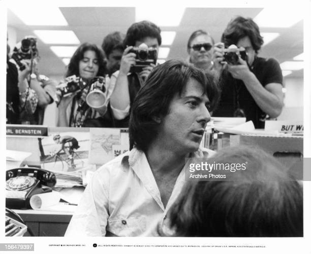 Dustin Hoffman being photographed in the newsroom in a scene from the film 'All The President's Men' 1976