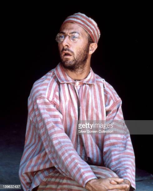 Dustin Hoffman, US actor, unshaven and wearing a red and white striped prison uniform with matching cap in a publicity still issued for the film,...