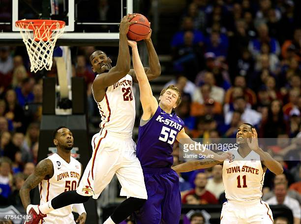 Dustin Hogue of the Iowa State Cyclones battles Will Spradling of the Kansas State Wildcats for a rebound as Monte Morris and DeAndre Kane look on...