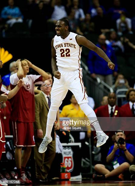 Dustin Hogue of the Iowa State Cyclones celebrates after their 67 to 65 win over the Oklahoma Sooners during a semifinal game of the 2015 Big 12...
