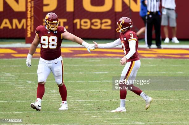 Dustin Hopkins and Matthew Ioannidis of the Washington Football Team after Hopkins's field goal in the second half against the Philadelphia Eagles at...