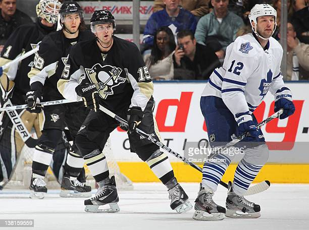 Dustin Jeffrey of the Pittsburgh Penguins keeps an eye on Tim Connolly of the Toronto Maple Leafs in a game on February 1 2012 at the Air Canada...