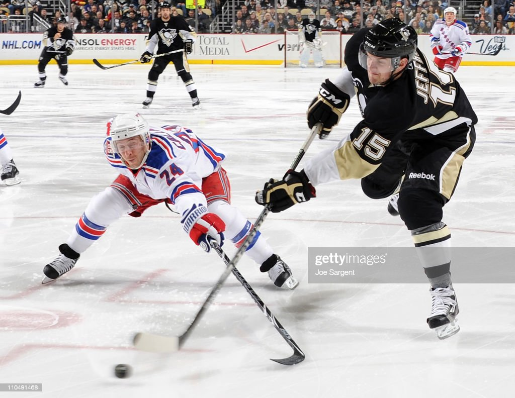 Dustin Jeffrey #15 of the Pittsburgh Penguins takes a shot in front Ryan Callahan #24 of the New York Rangers on March 20, 2011 at Consol Energy Center in Pittsburgh, Pennsylvania.