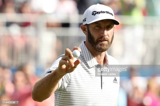 Dustin Johnson acknowledges the gallery after making his birdie putt on the 15th green during the third round of the 2019 RBC Heritage at Harbour...