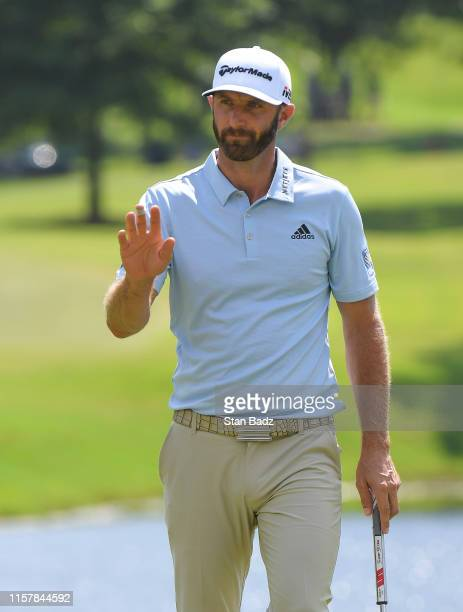Dustin Johnson acknowledges the gallery on the ninth hole during the second round of the World Golf Championships-FedEx St. Jude Invitational at TPC...