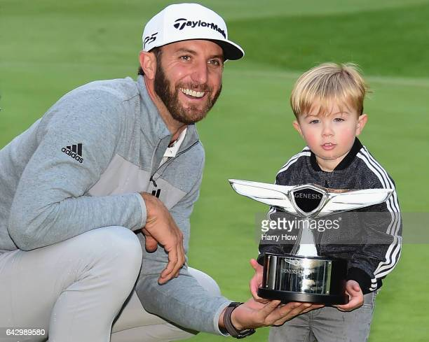 Dustin Johnson and his son Tatum pose with the trophy during the final round at the Genesis Open at Riviera Country Club on February 19 2017 in...