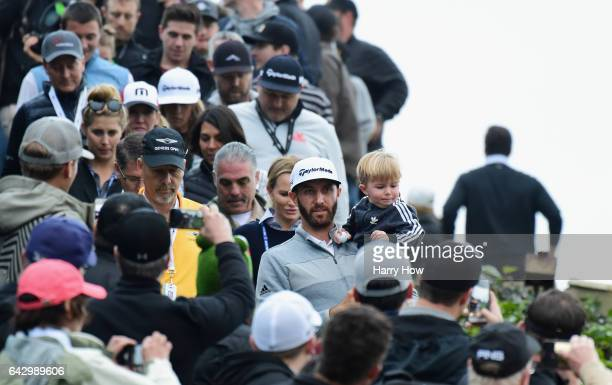 Dustin Johnson and his son Tatum walk down to the 18th hole during the final round at the Genesis Open at Riviera Country Club on February 19 2017 in...