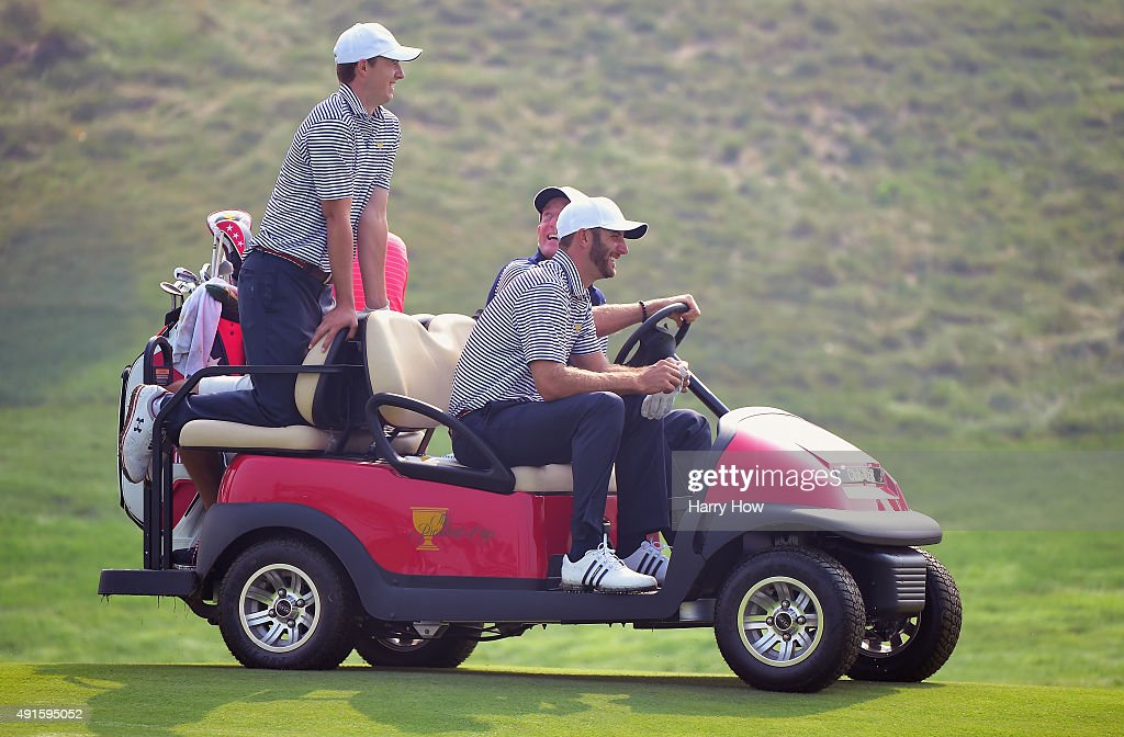 Dustin Johnson and Jordan Spieth of the United States team get a ride from Jim Furyk during a practice round prior to the start of The Presidents Cup at the Jack Nicklaus Golf Club on October 7, 2015 in Incheon City, South Korea.