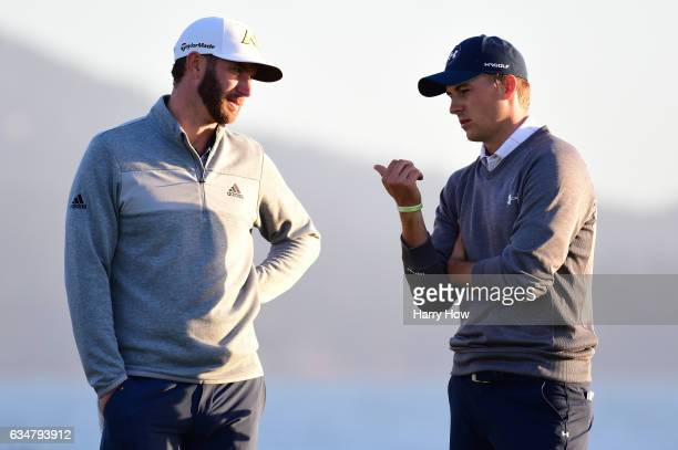 Dustin Johnson and Jordan Spieth speak on the 18th hole during Round Three of the ATT Pebble Beach ProAm at Pebble Beach Golf Links on February 11...