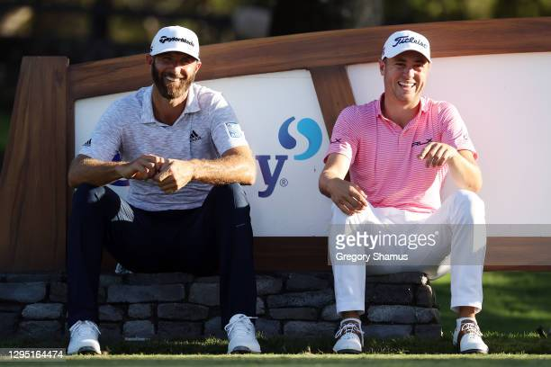Dustin Johnson and Justin Thomas of the United States laugh as they wait on the 18th tee during the first round of the Sentry Tournament Of Champions...
