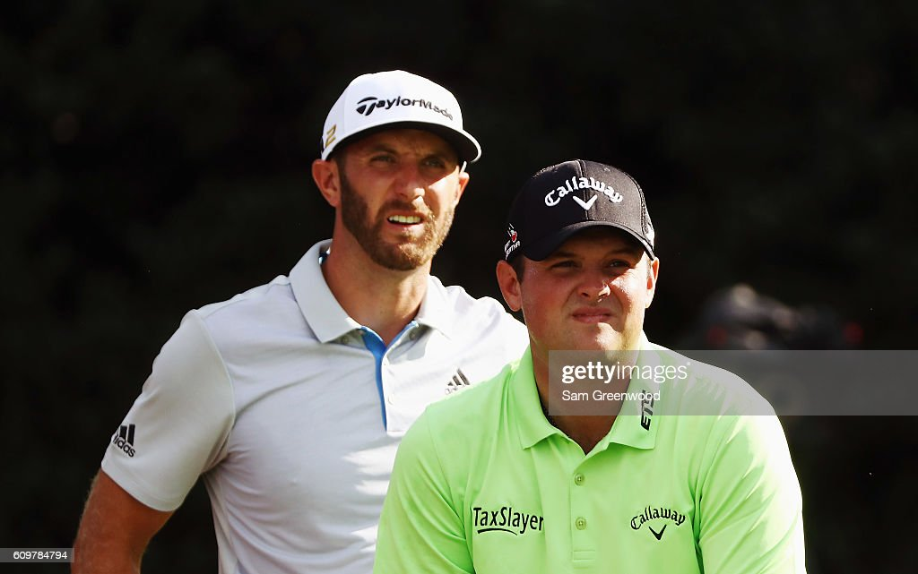 Dustin Johnson (L) and Patrick Reed wait on the 15th tee during the first round of the TOUR Championship By Coca-Cola at East Lake Golf Club on September 22, 2016 in Atlanta, Georgia.