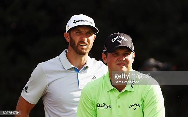 Dustin Johnson and Patrick Reed wait on the 15th tee during the first round of the TOUR Championship By CocaCola at East Lake Golf Club on September...