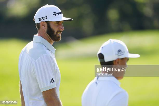 Dustin Johnson and Rickie Fowler of the United States walk on the 12th hole during round two of The Northern Trust at Glen Oaks Club on August 25...