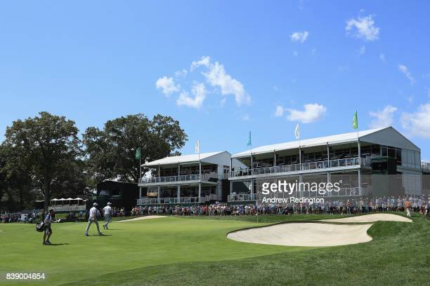 Dustin Johnson and Rickie Fowler of the United States walk onto the ninth green during round two of The Northern Trust at Glen Oaks Club on August 25...