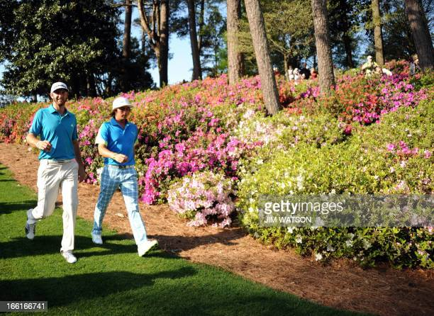 Dustin Johnson and Rickie Fowler of the US during a practice round at the 77th Masters golf tournament at Augusta National Golf Club on April 9 2013...