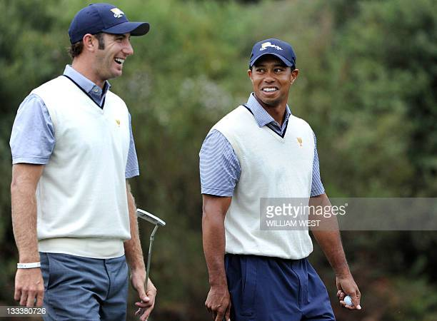 Dustin Johnson and Tiger Woods of the US laugh during their match on the third day of the President's Cup tournament played at the Royal Melbourne...