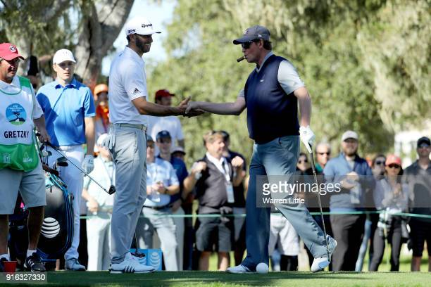Dustin Johnson and Wayne Gretzky meet at the 13th hole during Round Two of the ATT Pebble Beach ProAm at Monterey Peninsula Country Club on February...