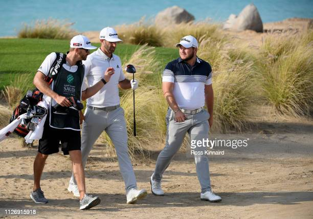 Dustin Johnson and Zander Lombard of South Africa on the par four 17th hole during the third round of the Saudi International at the Royal Greens...