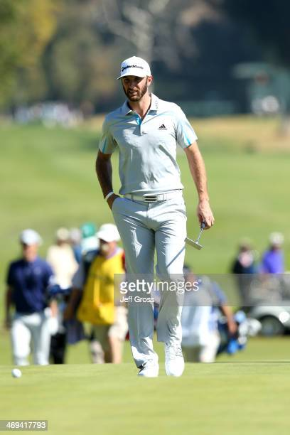 Dustin Johnson approaches his ball on the 2nd hole in the second round of the Northern Trust Open at the Riviera Country Club on February 14, 2014 in...