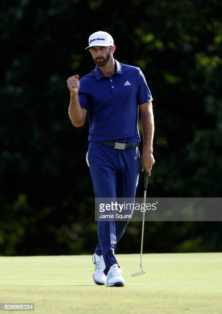 Dustin Johnson celebrates after making a birdie on the 15th hole during the final round of The Northern Trust on August 27 2017 in Westbury New York