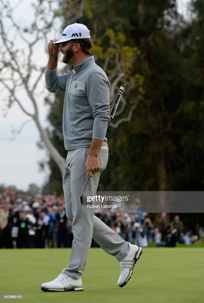 Dustin Johnson celebrates his win on the 18th hole during the final round at the Genesis Open at Riviera Country Club on February 19, 2017 in Pacific Palisades, California.