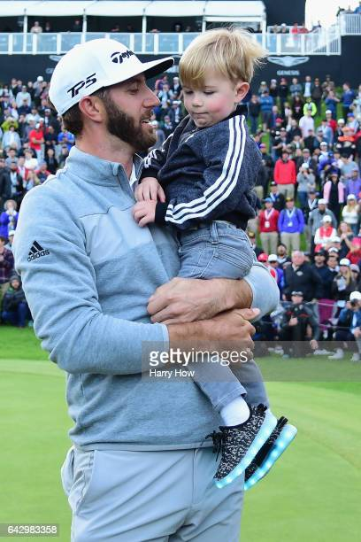 Dustin Johnson celebrates his win with his son Tatum on the 18th green during the final round at the Genesis Open at Riviera Country Club on February...