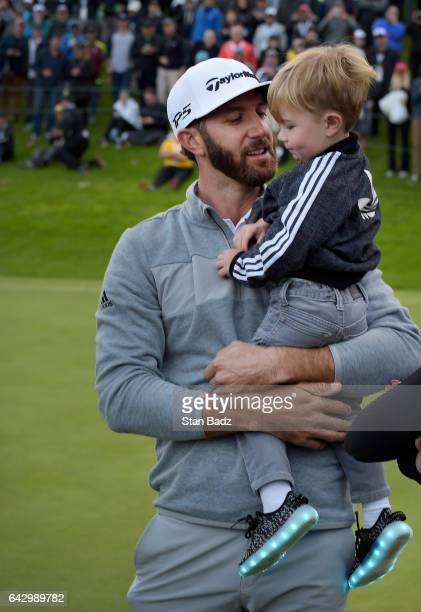 Dustin Johnson celebrates his win with his son Tatum on the 18th green during the final round of the Genesis Open at Riviera Country Club on February...