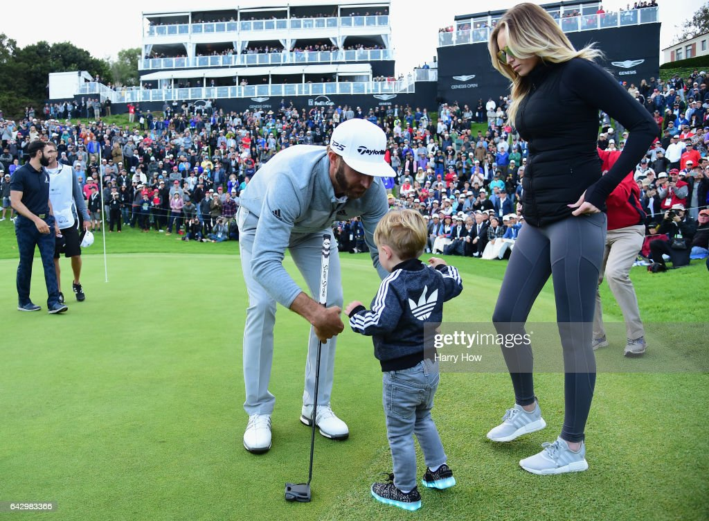 Dustin Johnson celebrates his win with wife Paulina Gretzky and son Tatum on the 18th green during the final round at the Genesis Open at Riviera Country Club on February 19, 2017 in Pacific Palisades, California.